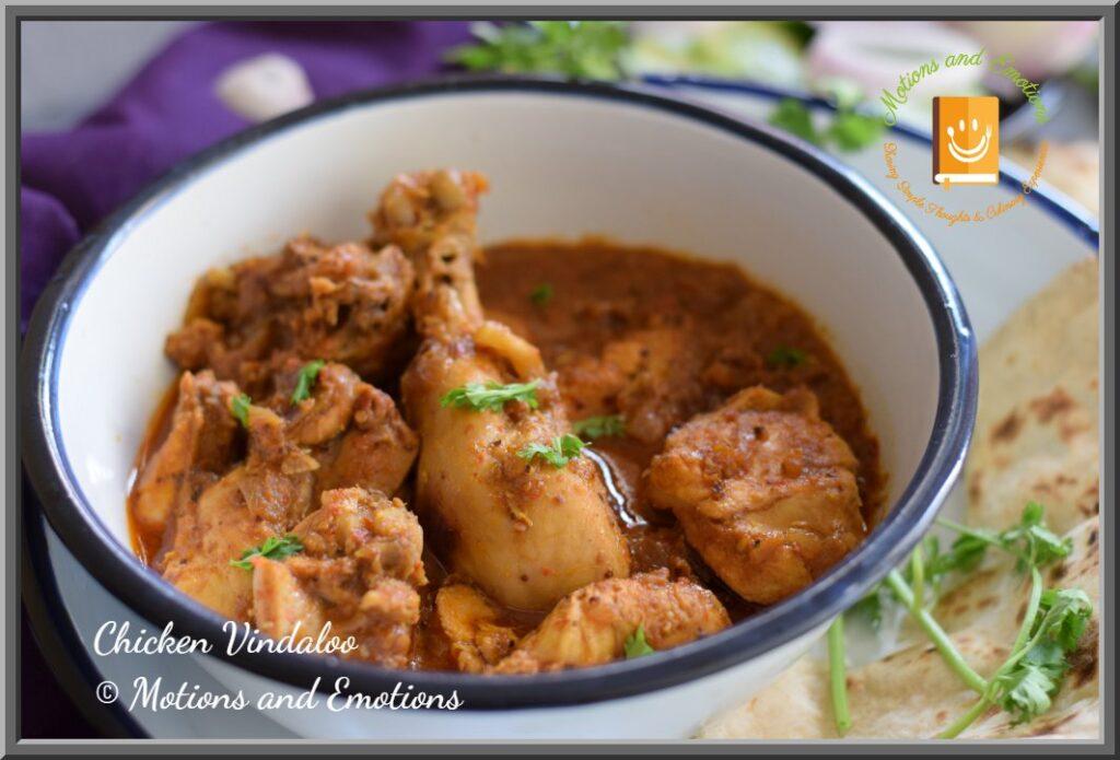 Close view of Goan Chicken Vindaloo in a white bowl
